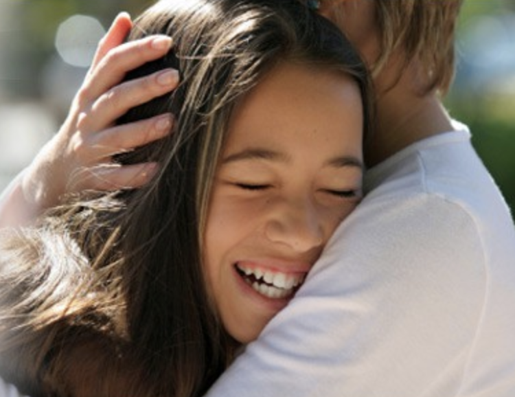 Girl being embraced – FosteringResilience.com