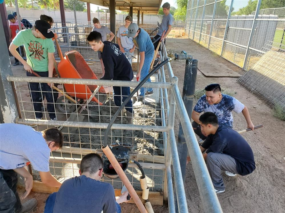 The GHS Ag Engineering & Fabrication 2 classes constructing concrete pads in the livestock pens at