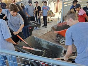 AG Students shoveling cement